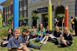 Author and Ardoch 'Writer in Residence' Emma Bowd, with Grade 3 and 4 students at Sunshine Primary School, Melbourne. Basking in the spring sunshine and reading their co-authored illustrated storybook, 'Pencil Pandemonium'. 2016