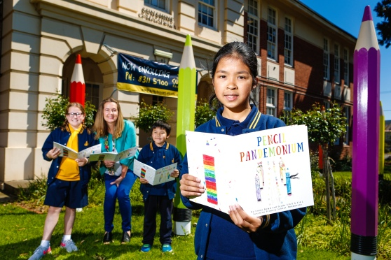 Star Weekly Newspaper: Sunshine Primary School student Elizabeth age 10 (front) with Makayla age 10 author Emma Bowd and Kenny age 8. Best selling author Emma Bowd has been conducting a book-writing workshop at Sunshine Primary School over the last two months.
